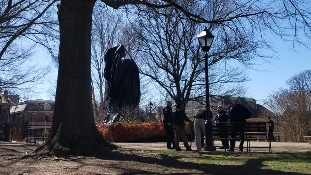 "Police standing by the covered statue of ""Stonewall"" Jackson"