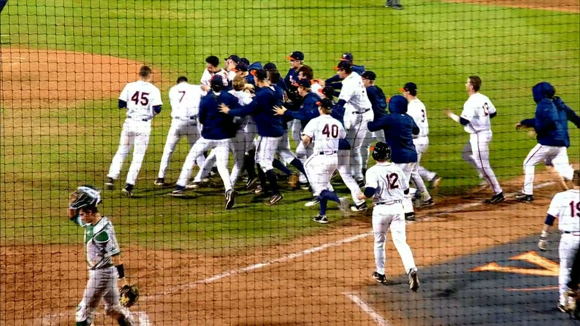 The UVa baseball team celebrates a walk-off win against William & Mary