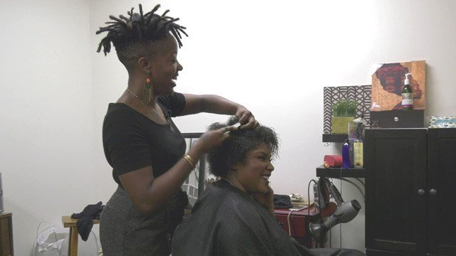 Yolonda Jones styling Madison Carter's hair