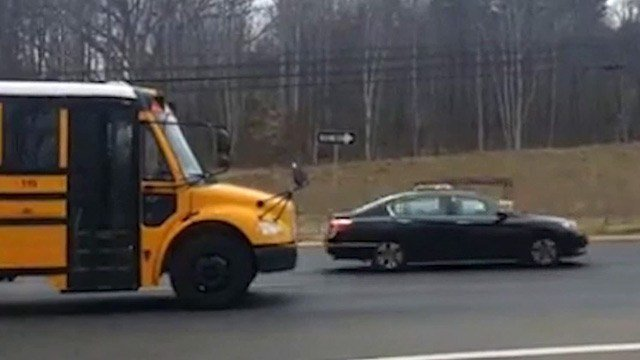 Video from a concerned parent showing a car illegally passing a stopped school bus along Route 29