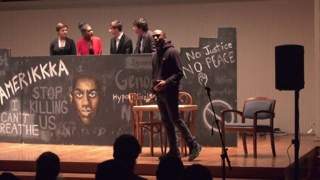 Joshua St. Hill and other students performing the play