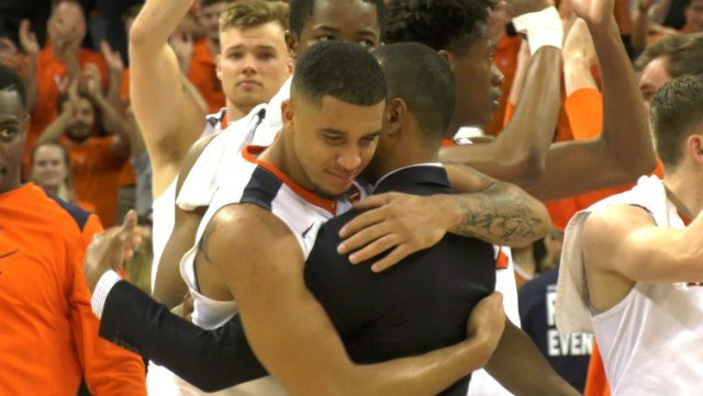 Isaiah Wilkins gave assistant coach Ron Sanchez a hug after the win