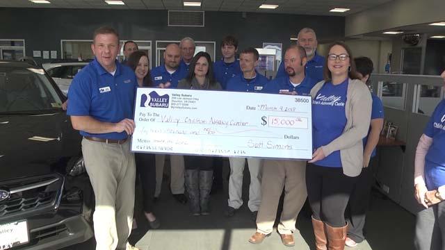 Valley Subaru presents the $15,000 check