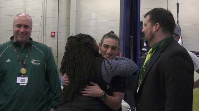 White gives student Matthew West a hug