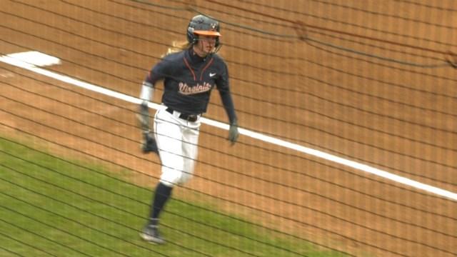 Allison Davis scores a run in Game One for UVa