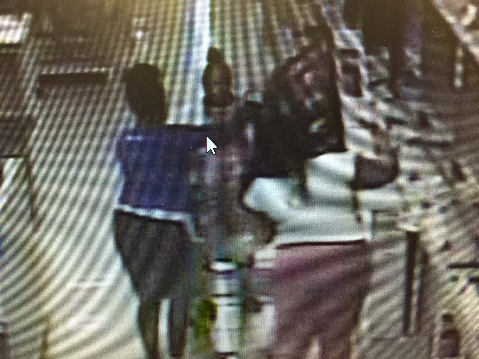 Surveillance Photo: Suspects loading first TV into cart