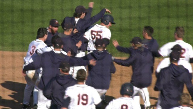 Cameron Comer (#55) is mobbed by his teammates after the game winning hit