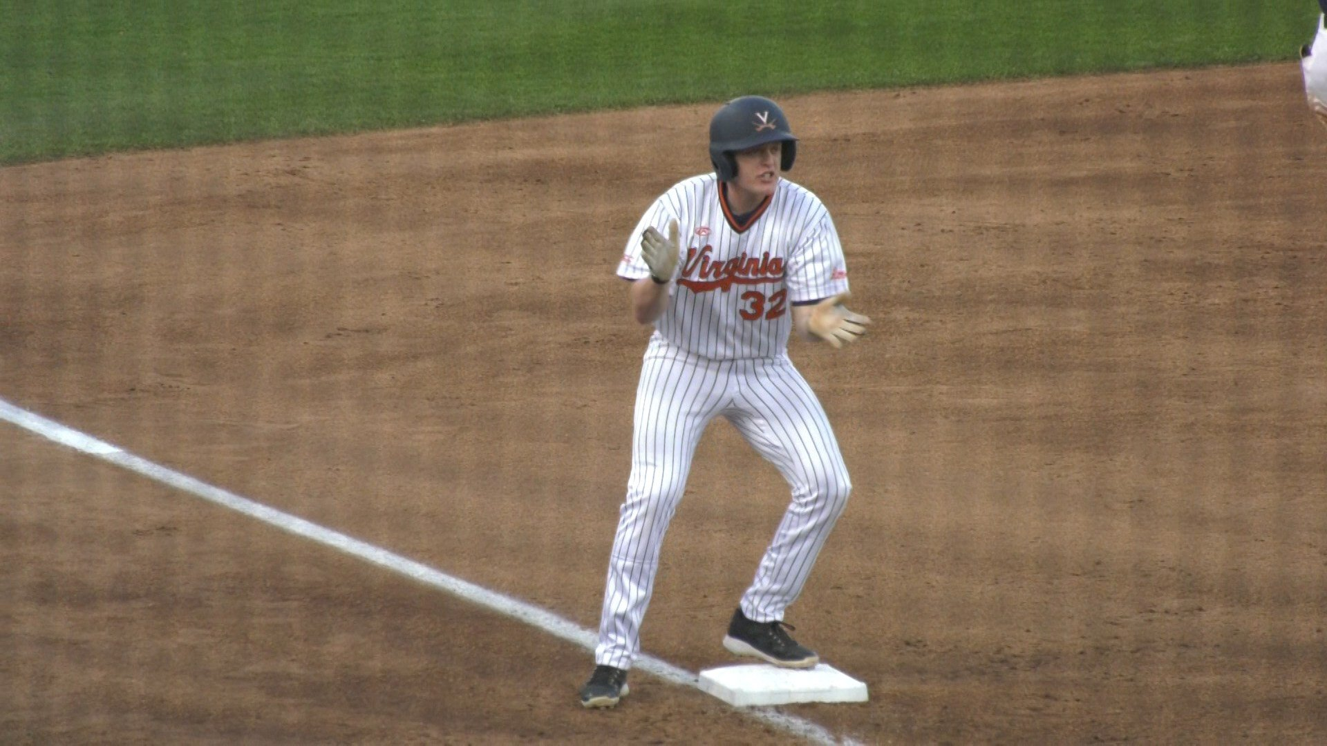 Nate Eikhoff celebrates after hitting a triple