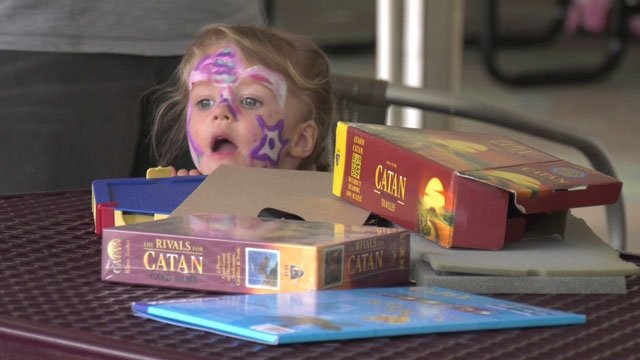 A young girl gazing at Catan.