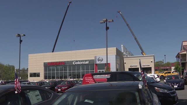 Crews putting in a solar superstructure at Colonial Nissan