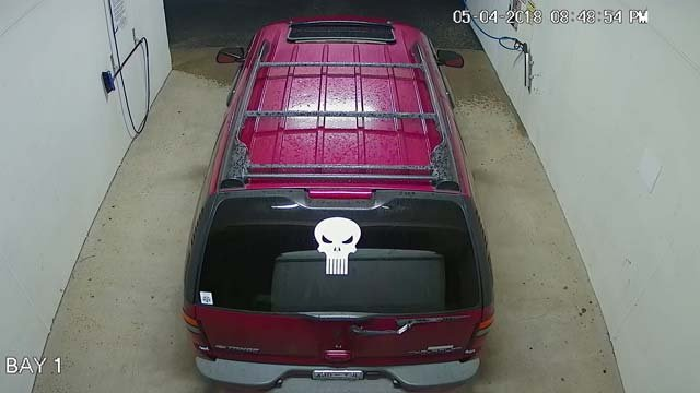 Police believe a burgundy Chevrolet Tahoe was present during the burglary