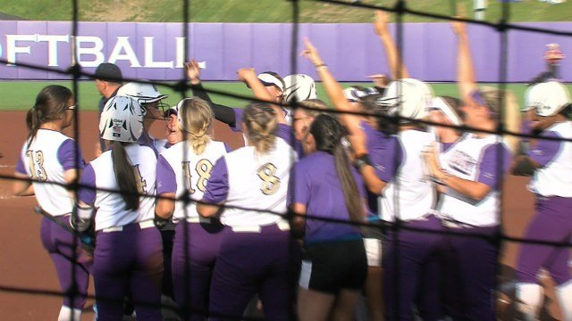 The Dukes celebrate a home run by Morgan Tolle