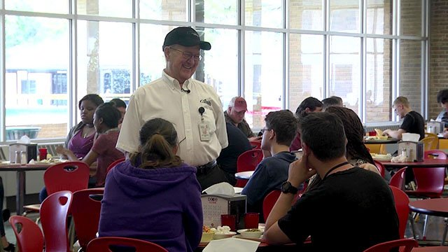 Bob Yankowski speaking with diners at the Yankowski Center for Culinary Excellence