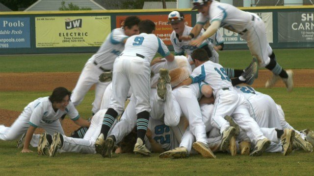 The Mavericks celebrated with a dogpile on the infield for the second year in a row