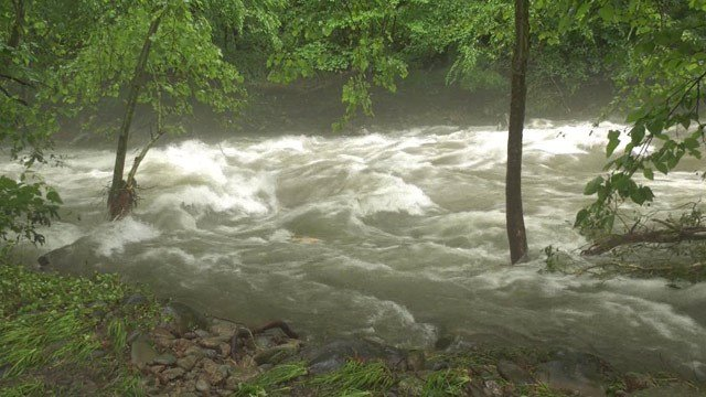 Rushing flood waters in Madison County (FILE IMAGE)