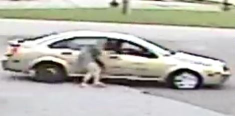 Surveillance photo of suspect getting into car with Emma Grace Kennedy