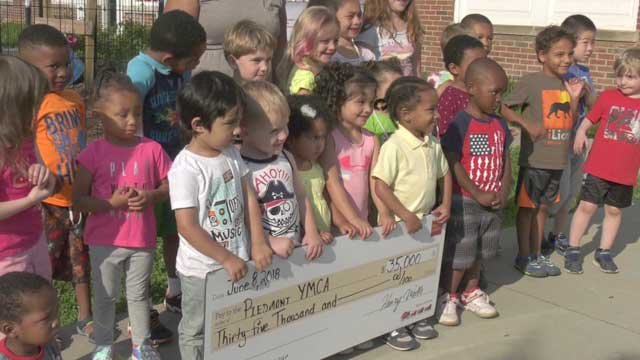 Some of the children got the chance to hold the check.