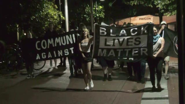 "People chanted ""Black Lives Matter"" as they marched"