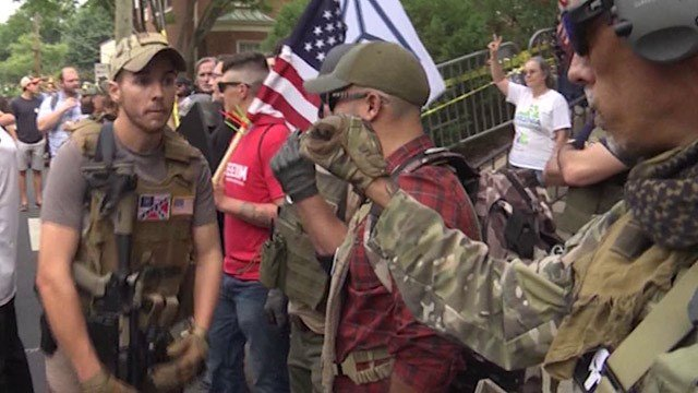 Militia members in downtown Charlottesville on August 12, 2017 (FILE IMAGE)