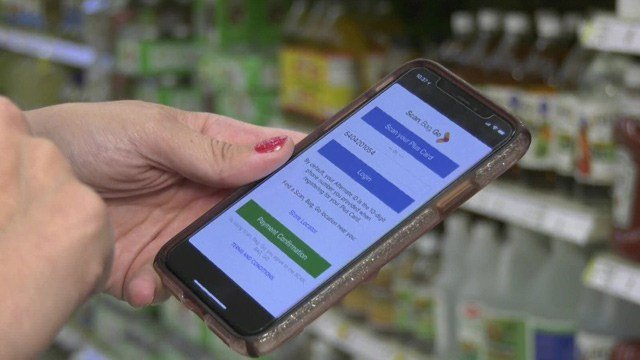 Shoppers can use their phones to scan their groceries as they shop.
