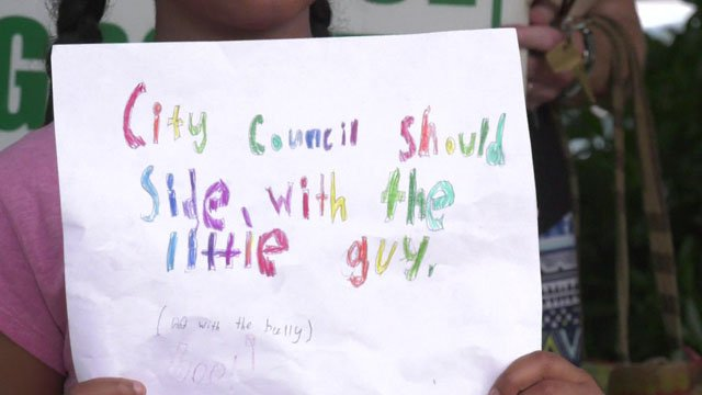 A sign held at the LHNA press conference directed at the Charlottesville City Council.
