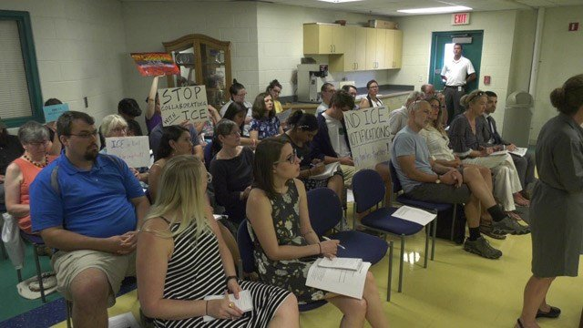 Community members gathered at ACRJ's board meeting on Thursday in protest.