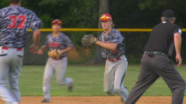 Jackson Webb throws home for an out against New Market