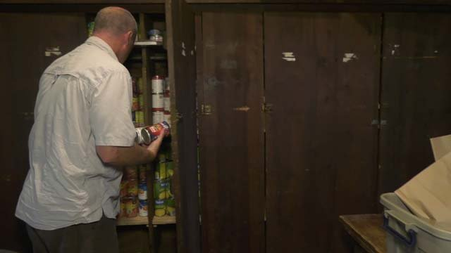 Brown supervises a group of students who volunteer at a food pantry