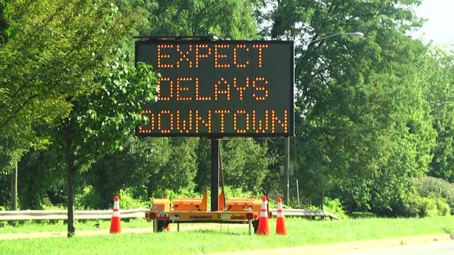 A sign along Route 250 warns drivers of delays downtown.