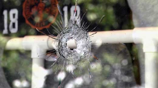 Bullet hole in Mincer's window