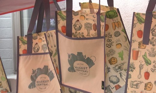 Members gave out free farmers market shopping bags to people who donated at least $20 to the cause.