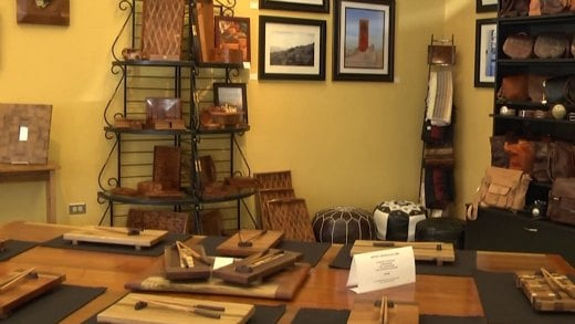 The store allows customers to shop for central Virginia paintings, furniture and pottery under one roof.