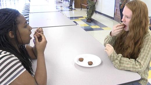 Students enjoying sweet potato muffins