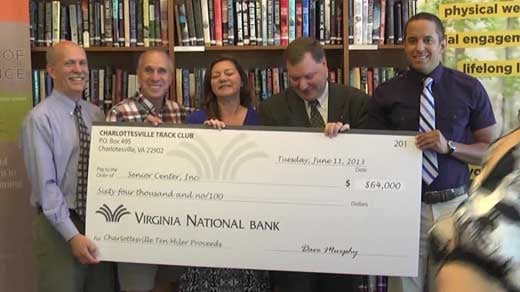 Senior Center staff accepting the donation from the Charlottesville Track Club
