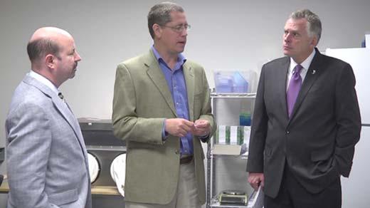 Michael Mann and Terry McAuliffe talk with Bill Walker, president of Hemosonics