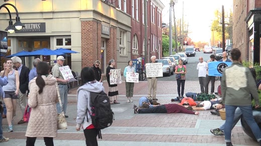 "Protesters against drone killings act out what they call a ""die-in"""