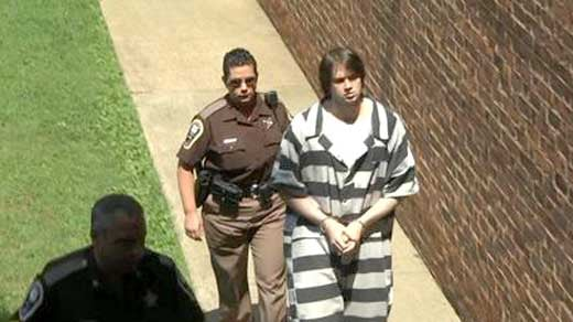 File photo: George Huguely being escorted to court during his trial.