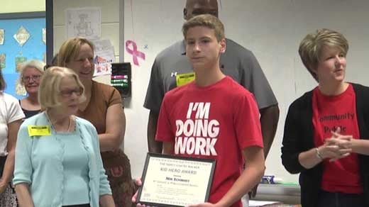 Nik Schmidt receiving the kid hero award.