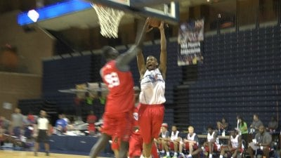 "Javin Montgomery-DeLaurier goes for the dunk against 7'5"" Tacko Fall"