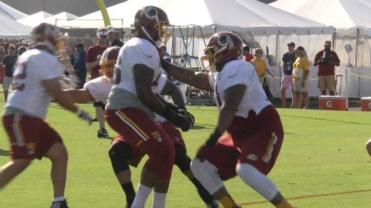 Morgan Moses works with Trent Williams at Practice