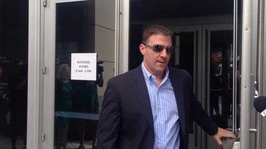 Mike Uncapher leaving court