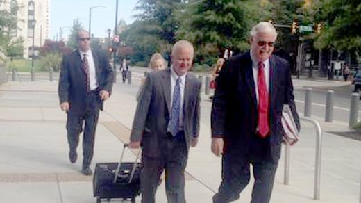 The prosecution team arriving at court
