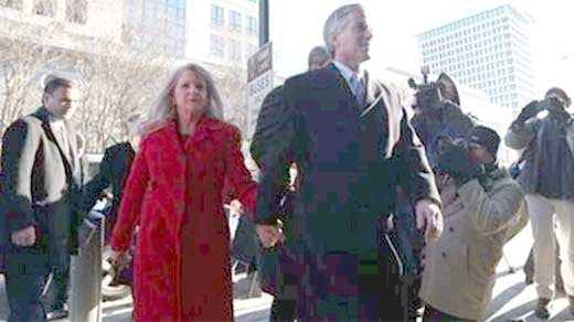 Bob and Maureen McDonnell holding hands as they walk into court for a pretrial motions hearing