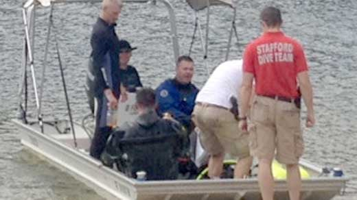 Divers preparing to enter the lake