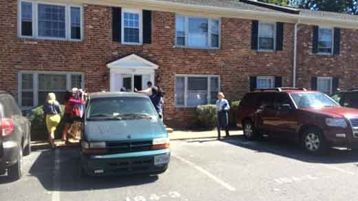 Police entering Jesse Matthew's apartment on Monday.
