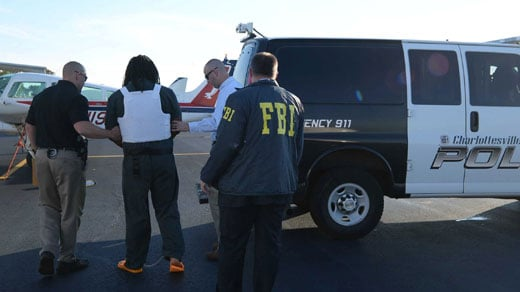 Jesse Matthew getting off plane in Charlottesville, photo courtesy of FBI Richmond photographer