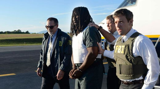 Jesse Matthew getting off the plane in Charlottesville, photo courtesy of FBI Richmond photographer