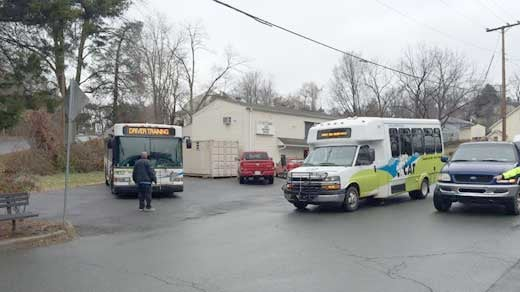 CAT buses at the BP station, evacuating residents from the area
