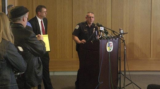 Police Chief Tim Longo holding a press conference