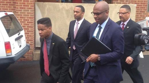 File Image: Martese Johnson with Attorney Daniel Watkins